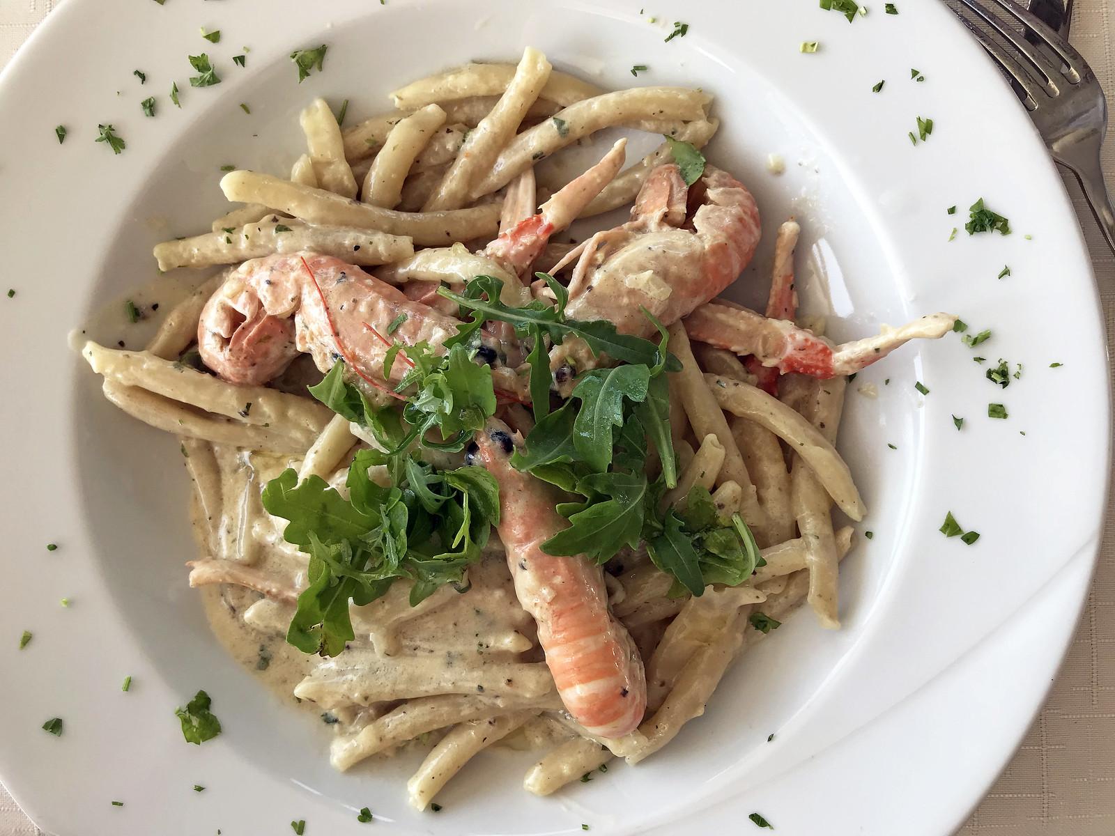 Homemade pasta with shrimp, truffle, and arugula at Lungomare Restaurant