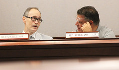 State Rep. Arthur O'Neill talks with Rep. Dave Rutigliano during a meeting of the Regulation Review Committee in Hartford on Tuesday, August 28.