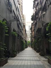 Gray arcades, narrow street opposite Rio Hotel, Macau