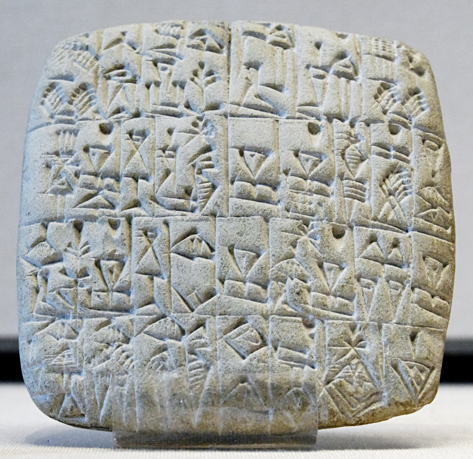 Sumarian tablet with a bill of sale of a male slave and a building in Shuruppak, circa 2600 BC.