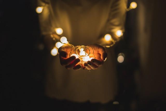 Light, hand, dark, and glow
