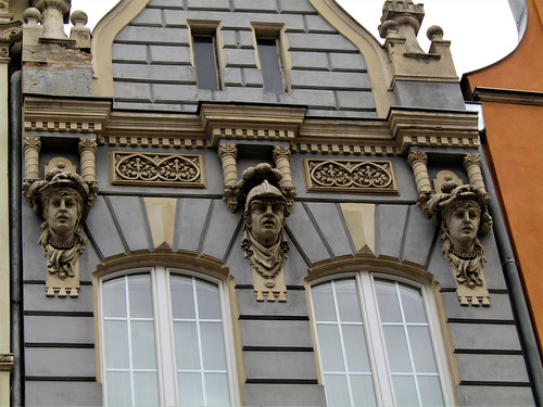 statues on facade of house in Long Street in Gdansk