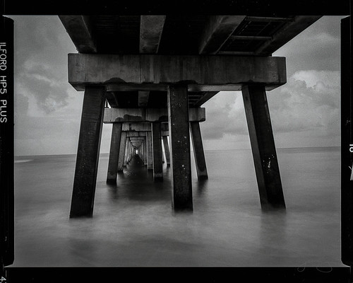 beach sunrise waves pier fishing gulf state park florida coast black white bronica etrs hp5 longexposure
