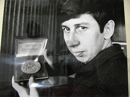 Larry Spanbauer with Assay medal