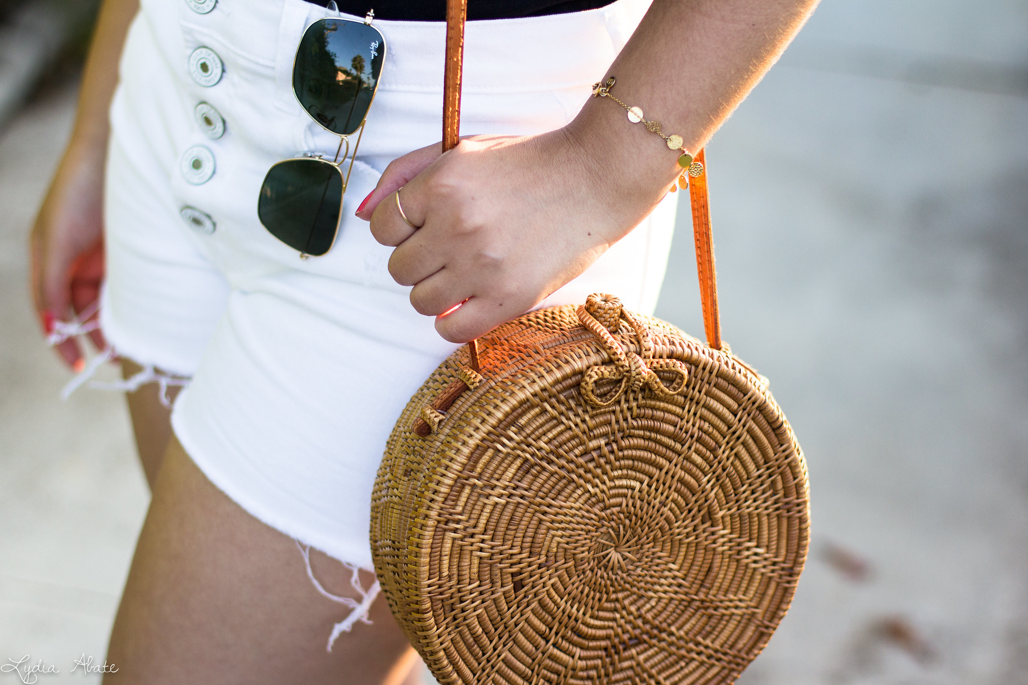 black off the shoulder top, round rattan bag, white button fly shorts-15.jpg