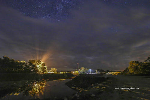 sky stars starrynight night clouds cloudy weather lights rays beams lightbeams lamppost astronomy water canal reflect reflection nature mothernature outdoors landscape stluciecounty fortpierce florida usa