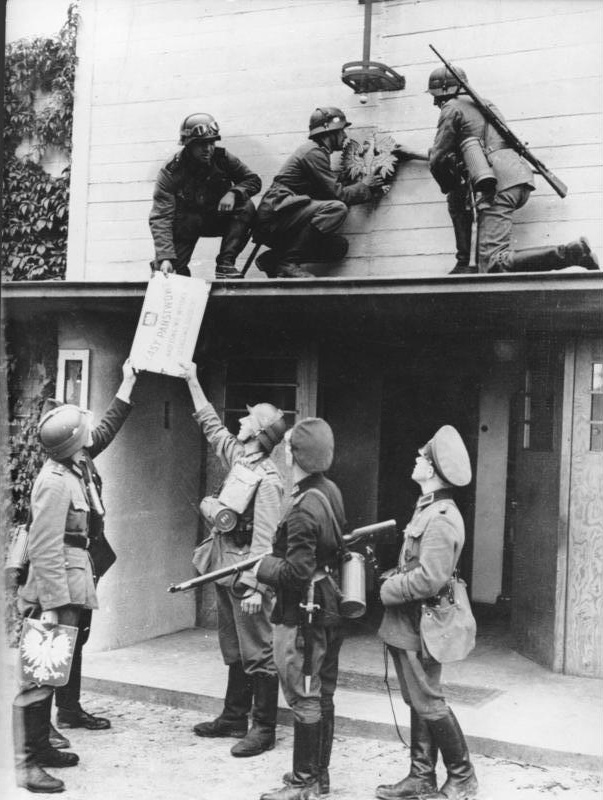 "After the German invasion of Poland German soldiers are removing Polish signs at the former border between Zoppot (today Sopot) and Gdingen (today Gdynia). The sign reads Lasy Państwowe, Nadleśnictwo Wysoka, Leśnictwo Gołębiewo meaning ""National Forests, forest inspectorate Wysoka, forest district Gołębiewo"" Photo taken by Hans Sönnke on September 1, 1939."