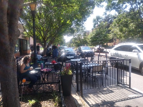 An in-street restaurant patio for Takoma Beverage Co. using parking spaces, Carroll Avenue, Takoma Park, Maryland