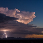 12. August 2018 - 21:01 - A monsoon thunderstorm lights up the fading desert sunset west of the Eagletail Mountains of Arizona.