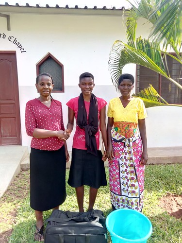 Madam Mercy & Mama Neema say goodbye to her as he heads off