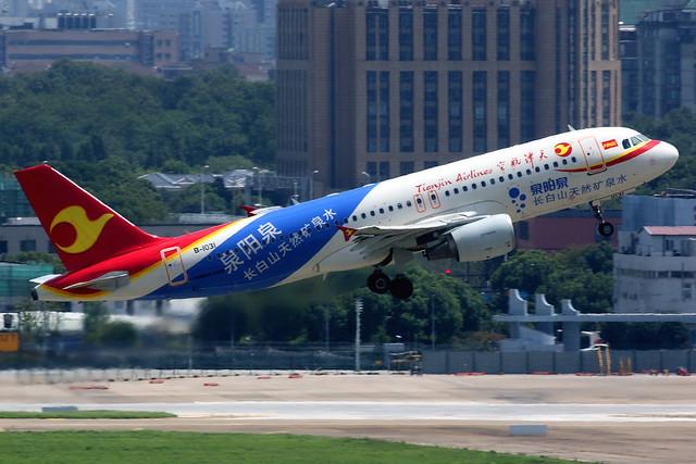 Tianjin Airlines | Airbus A320-200 | B-1031 | Quanyang Quan mineral water logos | Shanghai Hongqiao