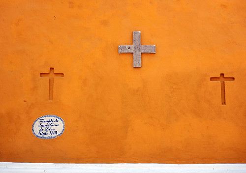 Crosses on a yellow wallin Puebla, a UNESCO Heritage site in Mexico