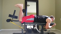 Leg Curls with Bands on Ironmaster Bench