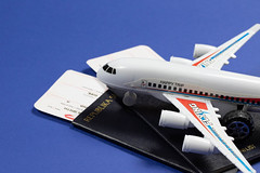 Toy plane on passports and tickets
