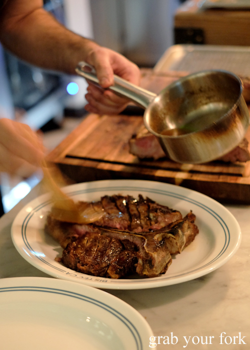 Basting the bistecca alla fiorentina with burnt butter and beef dripping at Bistecca Sydney
