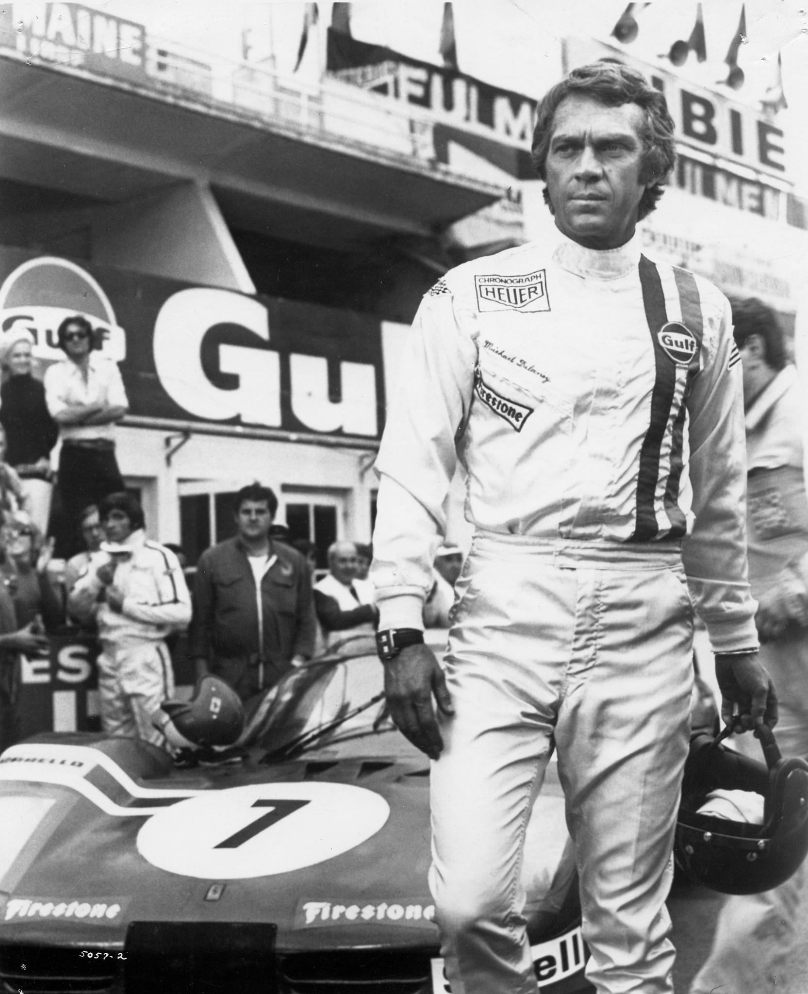 Steve McQueen on Le Mans race track with Heuer Monaco watch on.