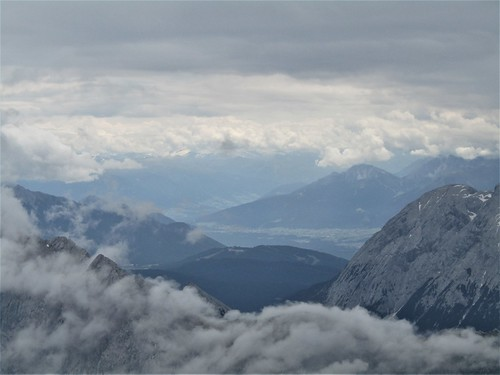 view on mountains and valley from top of the Zugspitze