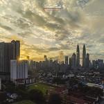 Serene sunrise above Kuala Lumpur skyline