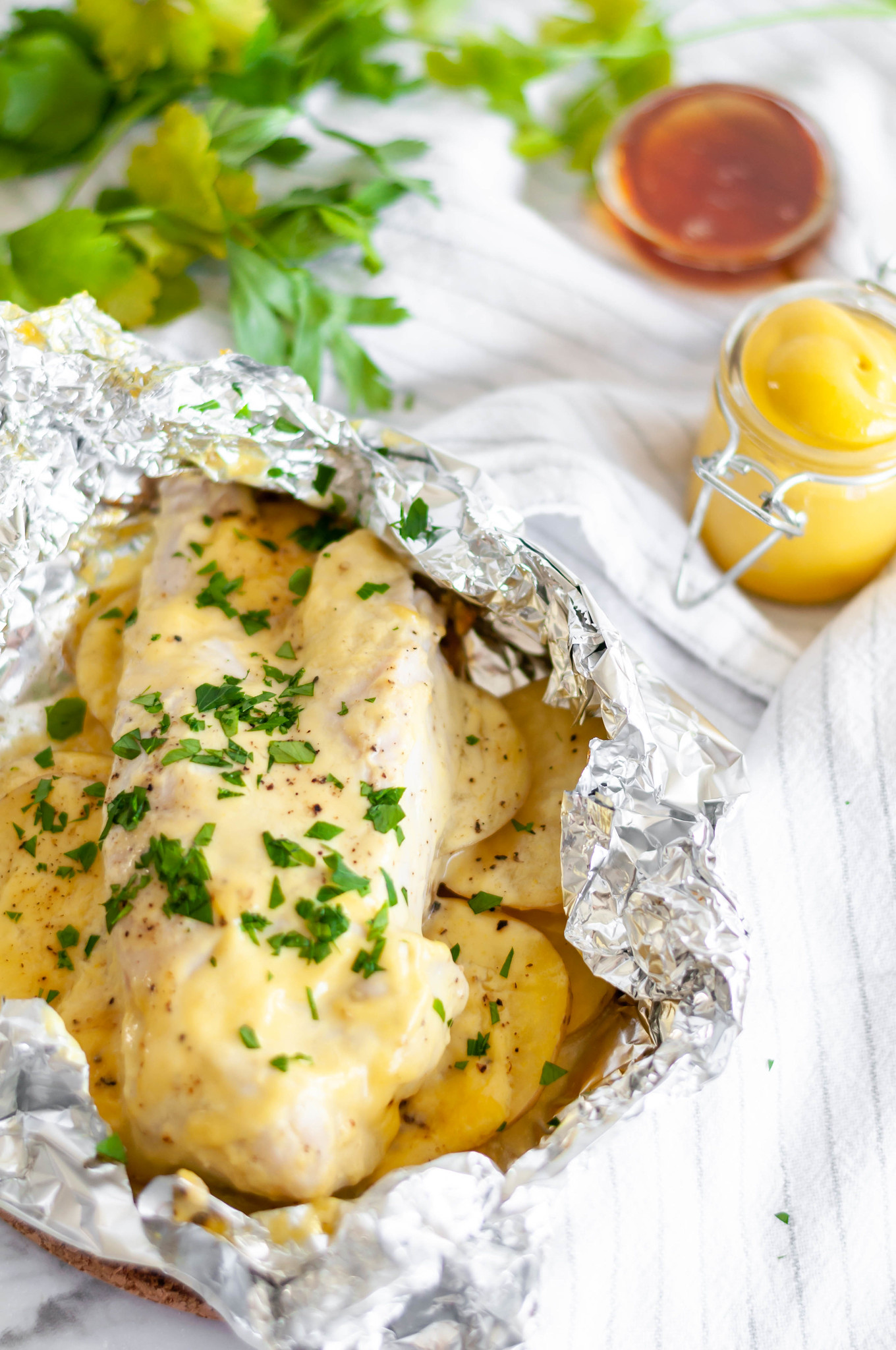 Honey Mustard Chicken and Potato Foil Packs are a simple weeknight dinner the whole family will love. Chicken breasts, thinly sliced potatoes and a simple homemade honey mustard sauce.