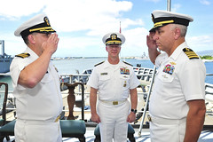 Capt. Michael Luckett, right, relieves Capt. Douglas A. Bradley, left, during the ceremony aboard USS Emory S. Land (AS 39). (U.S. Navy/MC2 Richard A. Miller)