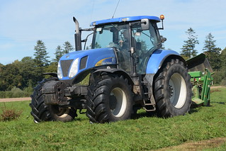 New Holland T7050 Tractor with a John Deere 630 Mower Conditioner