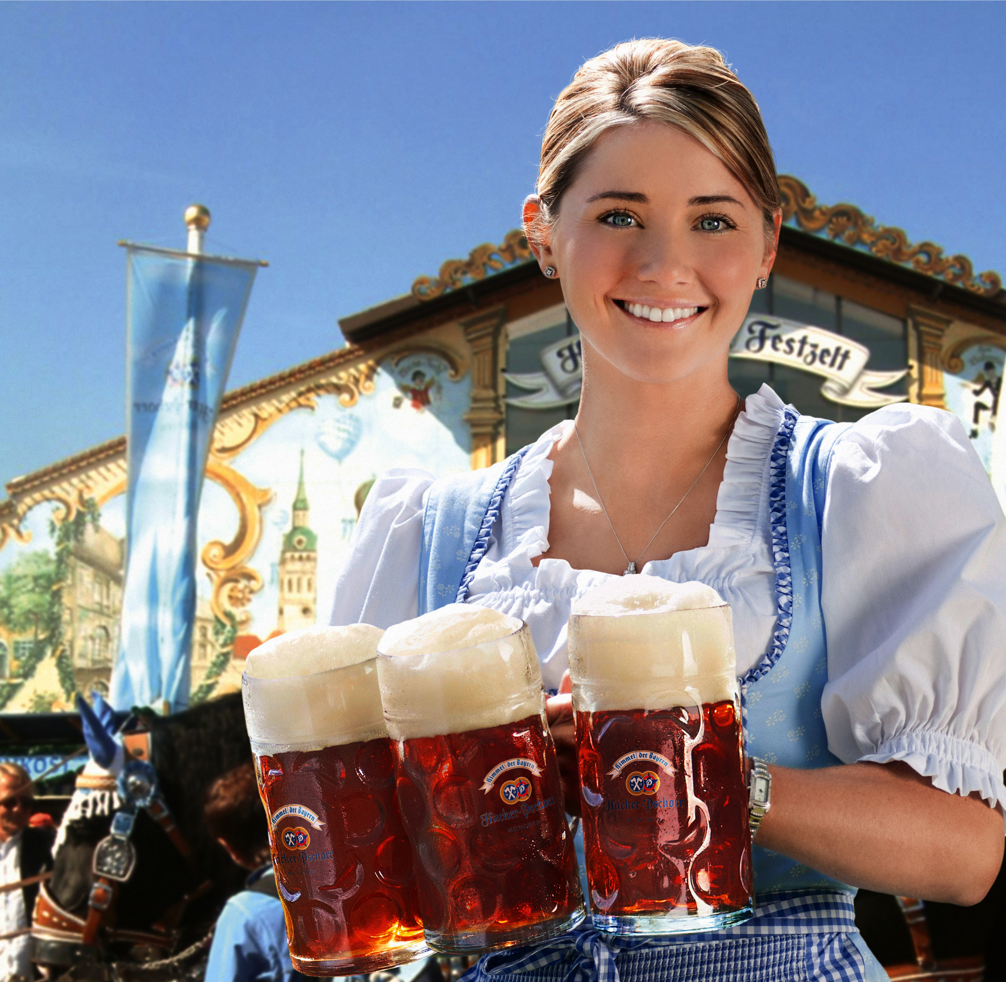 A waitress with Hacker-Pschorr, one of the traditional beers allowed to be served at Oktoberfest. She wears a dirndl, a traditional women's dress of Bavaria. Photo taken by Mark Burger in 2011.