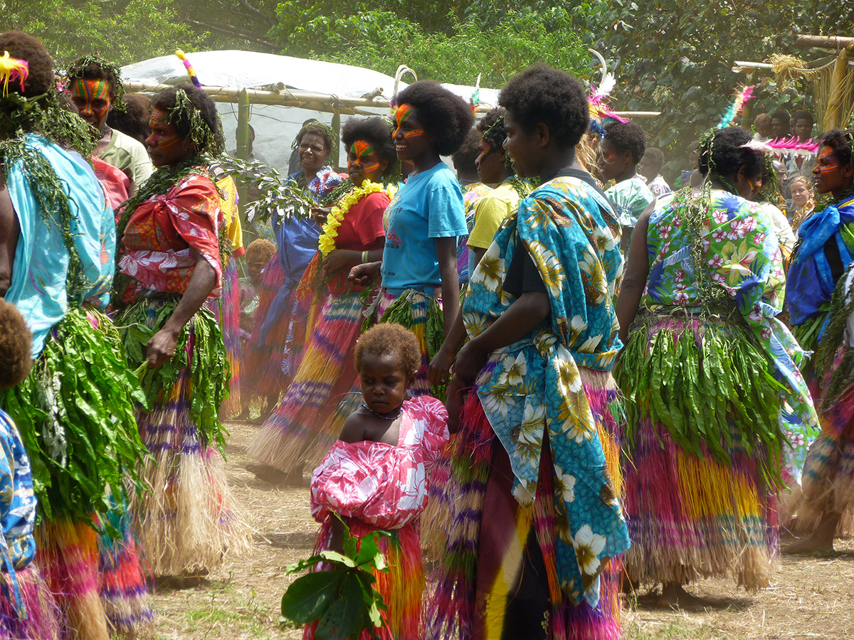 Female Tannese women participating in traditional cultural dancing as a part of a prominent  John Frum celebration in middlebusg, Tanna island.