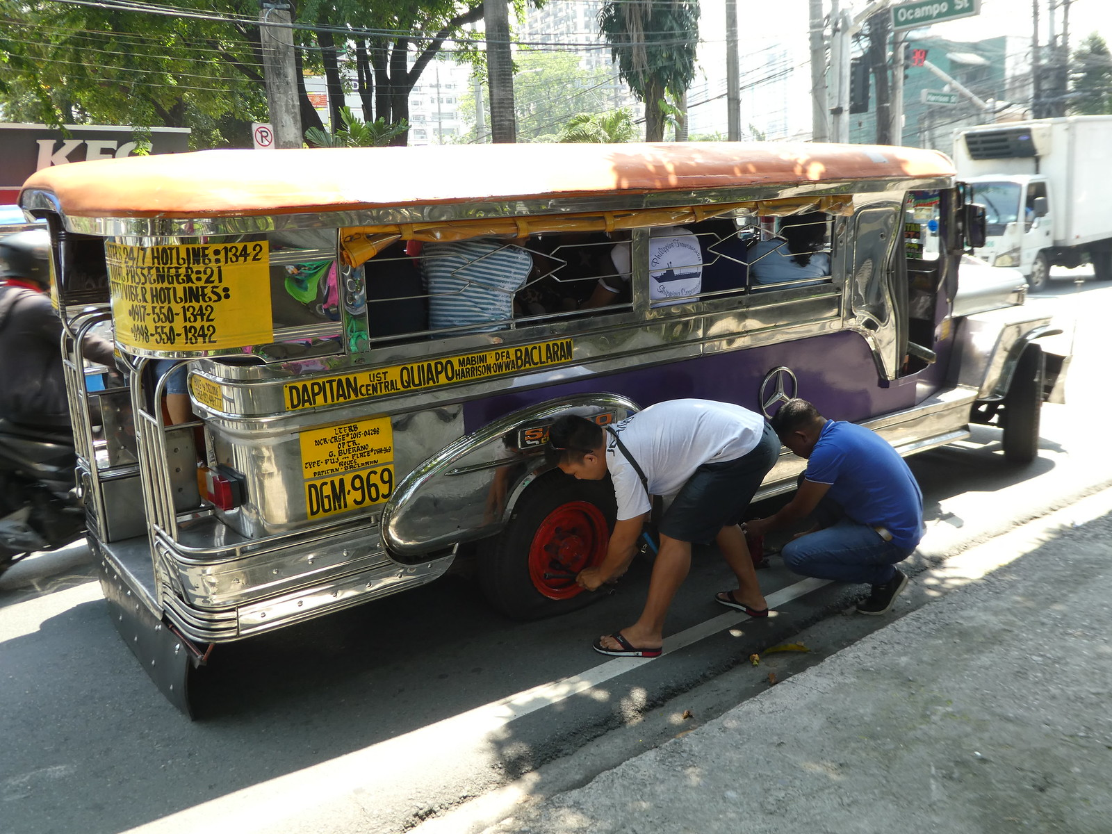 A jeepney having a tyre change, Manila