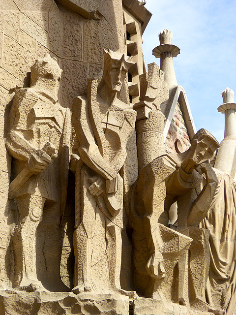 The block styled sculptures of figures adorning the entrance to the Basilica de la Sagrada Familia in Barcelona, highlighting some of the extraordinary work incorporated within the iconic Barcelona Church