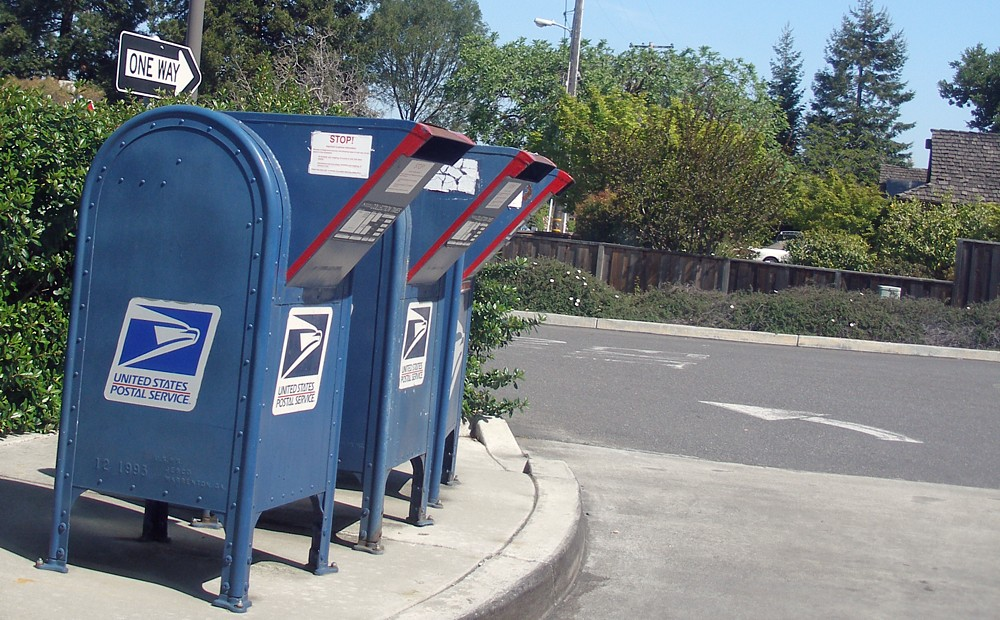 A drive-through lane at a post office operated by the United States Postal Service in Los Altos, California, featuring