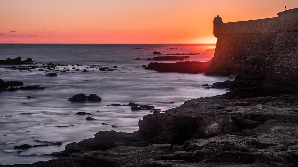 Sunset over the castle, Cadiz, Spain picture