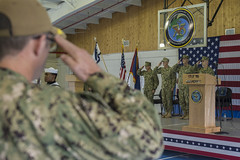 The official party salutes as the national anthem plays during the CTF 75 change of command ceremony. (U.S. Navy/MC2 Kory Alsberry)
