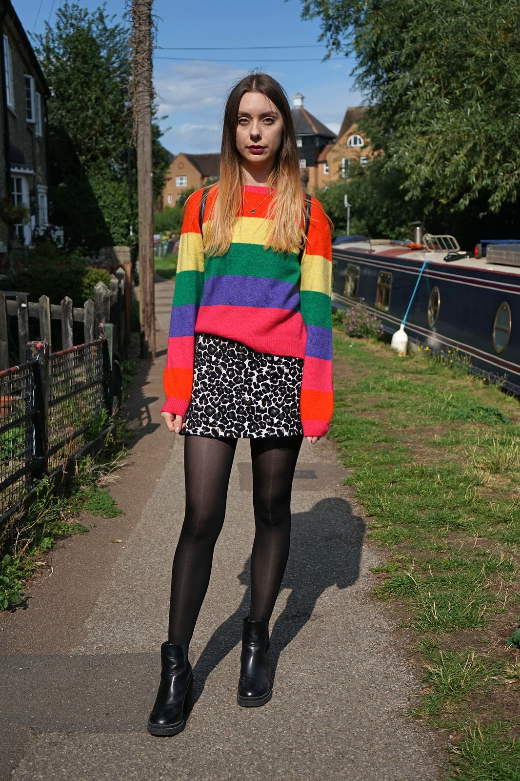 Primark rainbow striped jumper and a leopard skirt