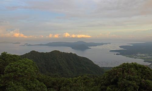 volcano island setting sun illuminating clouds tagaytay philippines taal