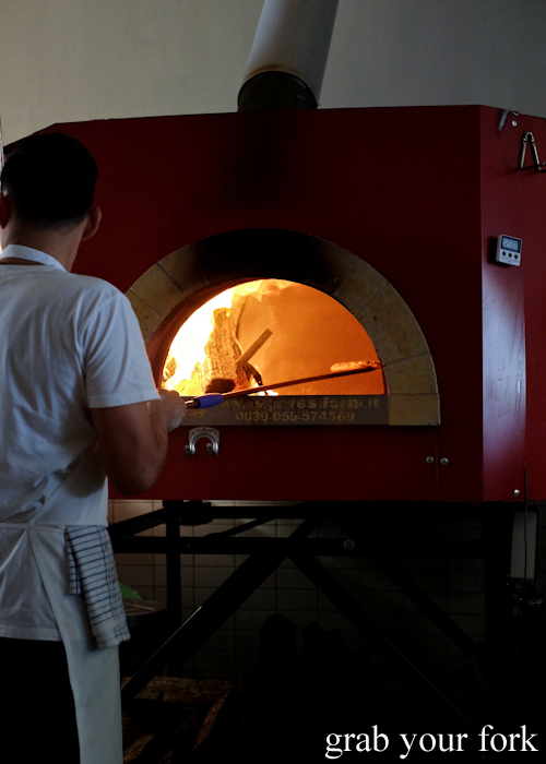 Cooking pizzas in the Italian wood-fired oven at Bella Brutta Pizza in Newtown