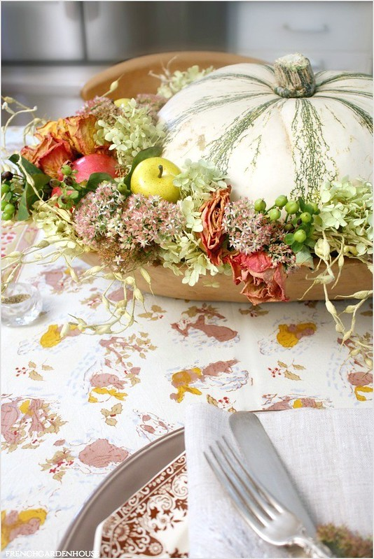 Pumpkin-centerpiece-in-antique-French-trencher-on-french-country-tablecloth-1