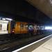 West Midlands Railway 172 337 at Birmingham Snow Hill Station in orange and purple
