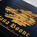 Custom illustration portfolio book in hand-stained ebony bamboo with an engraving treatment