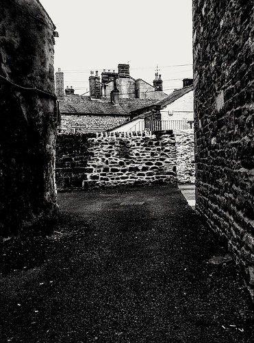 gloomy drab clithero alleyway brick path oldworld bw