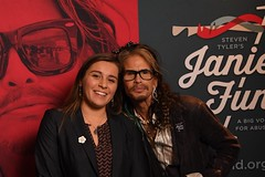 steven tyler with kayla in front of banner ywoe 18 landscape