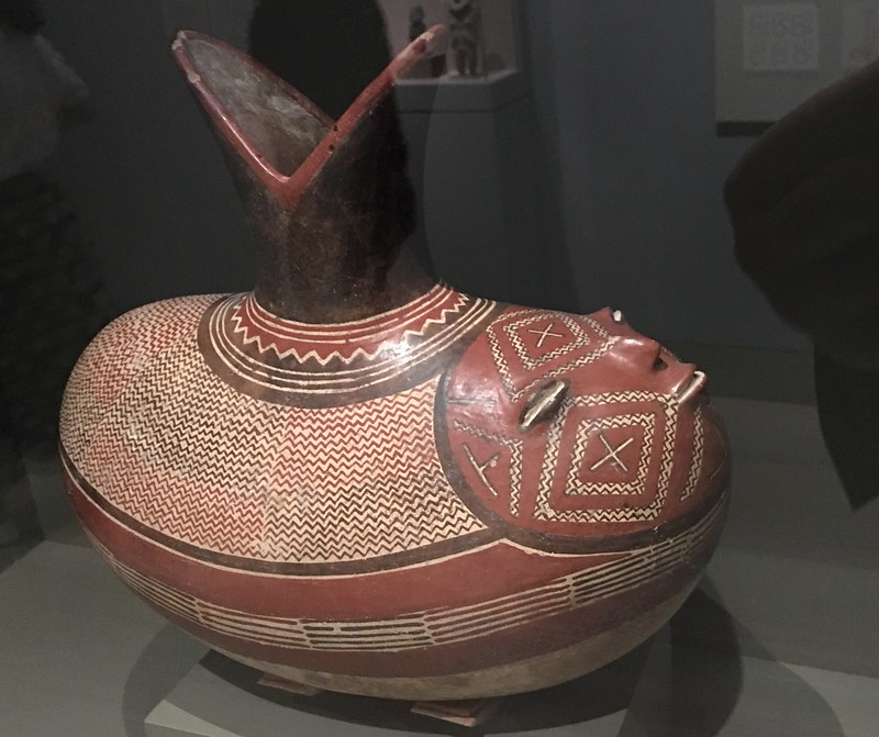 Elliptical bottle depicting a sprouting bean with a human face. 300-100 BC, Mexico