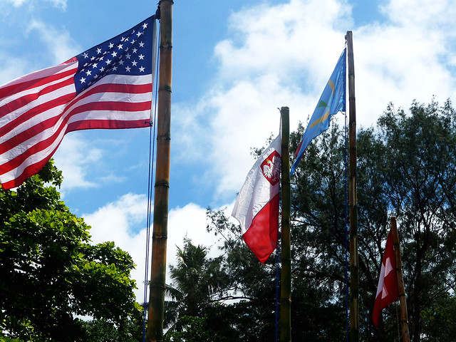 Raised flags at a John frum celebration of which the United states Flag has a pride of place due to the association  of the cult with US military during the Second Wourld War.
