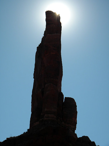Dark rock pinnacle blocking the sun at the Valley of the Gods near Mexican Hat in Utah