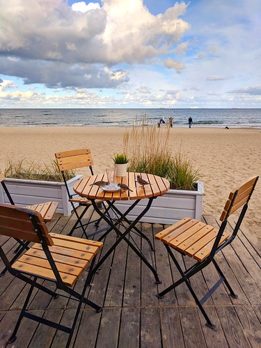 sopot poland resort spa cafe roundtable frenchbistro sunny sand outdoors relaxing elegance deck view gdanskbay shore horizon pixelphone mobilephotography birds dishes crumbs greatday holiday