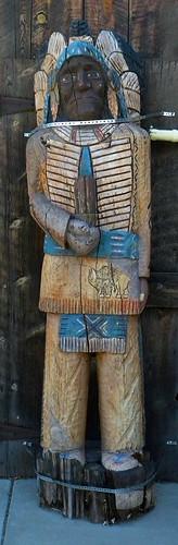 A wooden Indian folk art statue at Grand Canyon, Arizona