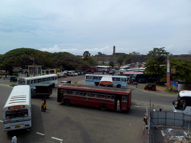 Buses at Galle station in Sri Lanka. Galle Fort is in the background.
