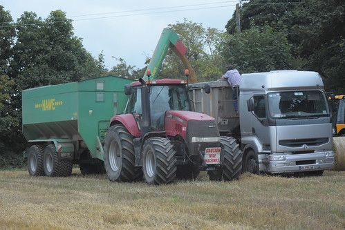 Case IH Magnum 335 Tractor with a Hawe Grain Chaser Bin to a Dennison Tipper Trailer drawn by a Renault Premium 420 Truck