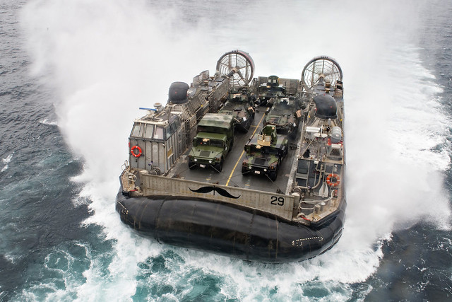 EAST CHINA SEA (Oct. 14, 2018) A landing craft, air cushion assigned to Naval Beach Unit (NBU) 7 prepares to enter the well deck of the amphibious assault ship USS Wasp (LHD 1) during integrated unit level training. Wasp, flagship of Wasp Amphibious Ready Group, with embarked 31st Marine Expeditionary Unit, is operating in the Indo-Pacific region to enhance interoperability with partners and serve as a ready-response force for any type of contingency. (U.S. Navy photo by Mass Communication Specialist 3rd Class Taylor King)