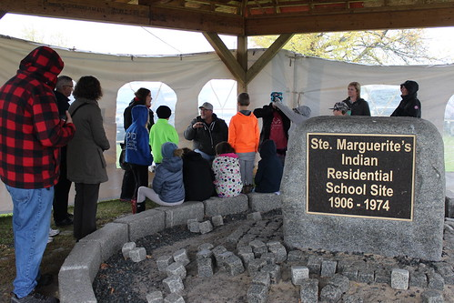 <p>Fall Harvest participants learn about residential schools from a Residential School Survivor</p>