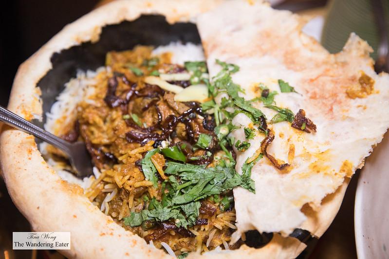 Lucknow Dum Biryani - Slow-cooked goat, basmati rice, saffron